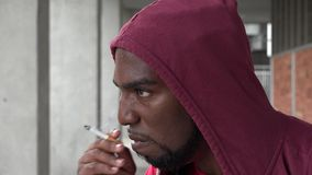 Young Urban Male Smoking. Stock video of an African American man stock video footage