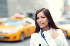 Young urban professional business woman New York. Young urban professional business woman in New York City Manhattan. Woman walking in street wearing coat Stock Images