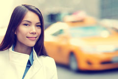 Young urban professional business woman New York. Young urban professional business woman in New York City Manhattan. Woman walking in street wearing coat Royalty Free Stock Image