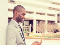 Young urban professional man using smart phone Stock Photography