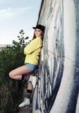 Young Urban Teenage Girl near Wall Stock Photography