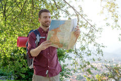 Young urban traveler consulting a map Royalty Free Stock Photos