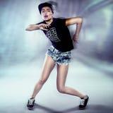 Young urban woman dancing