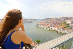 Young urban woman enjoying wind in her face when looking at Porto City, Portugal, Europe stock photography