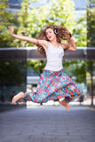 Young urban woman jumping Stock Photos