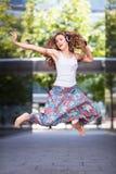 Young urban woman jumping Stock Photos
