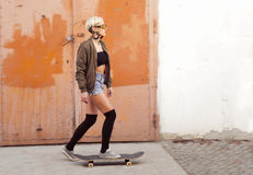 Young urban woman skateboarding Stock Photos