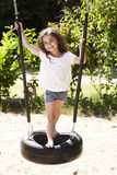 Young url on swing, smiling Royalty Free Stock Image