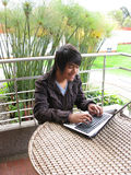 Young using laptop outdoors Stock Photo