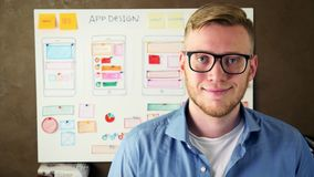 Young UX designer smiling in creative agency office. Stock footage stock video footage
