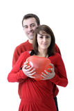 Young valentine couple with heartshaped balloon Stock Image