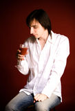 Young vampire. With glass of blood Royalty Free Stock Photography