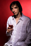 Young vampire. With glass of blood Stock Photos