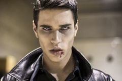 Young Vampire Man Face with Blood on his Mouth Royalty Free Stock Photos