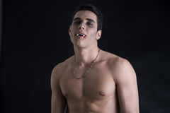 Young Vampire Man Shirtless, Gesturing to Camera Royalty Free Stock Photos