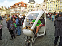 Young Velotrixi driver in Old Town Square stock photo