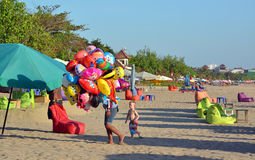 Young Vendor of Animal Shaped Balloons at Legian Beach Royalty Free Stock Photos