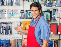 Young Vendor Welcoming At Hardware Shop Stock Image