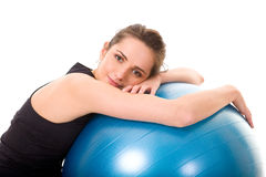 Young, very attractive female with blue ball Stock Photo