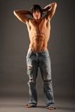 Young very muscular half-naked male standing Royalty Free Stock Images