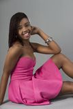 Young Vibrant Black Female wear pink dress Stock Image