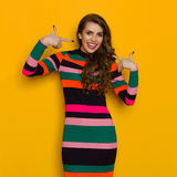 Young Vibrant Woman Is Pointing At Her Smile Stock Photo
