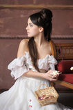 Young victorian lady. Portrait of a beautiful young victorian lady in white dress Royalty Free Stock Photo