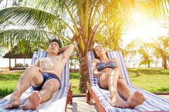 Sunbathing couple royalty free stock photo