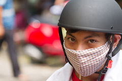 Young Vietnamese man with helmet & face mask in Danang Stock Photography