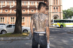 Young Vietnamese man with tattoos. People in Asia trust that tattoos will protect them from their enemies and evil spirits Royalty Free Stock Photos