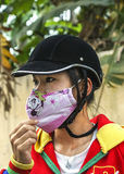 Young Vietnamese women with face covering mask. Royalty Free Stock Photography