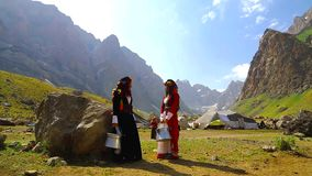 Young village women carrying water from the well have a talk stock video