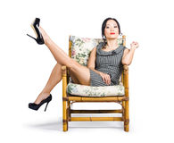 Young vintage fashion model sitting on chair Royalty Free Stock Photos