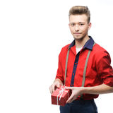 Young vintage man holding gift Royalty Free Stock Image