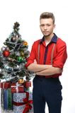 Young vintage man standing near christmas tree Stock Photography