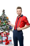 Young vintage man standing near christmas tree Royalty Free Stock Photography