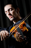Young violin player playing Royalty Free Stock Photo