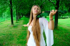 Young violinist. Finishing her playing royalty free stock photos