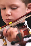 Young violinist. Cute young boy playing the violin Royalty Free Stock Image