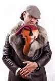 A young violinist with his violin Stock Photo