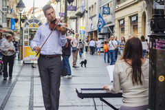 Young violinist playing on a street Stock Image