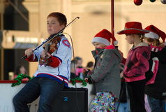 Young violinist at Santa Clause Parade Royalty Free Stock Images