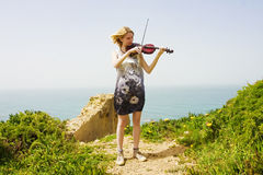 Young violinist at seaside Royalty Free Stock Images