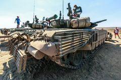 Young visitors of the exhibition inspect the tanks T-72. KADAMOVSKIY TRAINING GROUND, ROSTOV REGION, RUSSIA, 26 AUGUST 2017: International military technical Royalty Free Stock Photo
