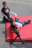 Young visitors with M249 light machine gun during Fleet Week 2017 in New York Stock Image