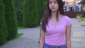 Young visually impaired asian woman with a cane is in the park close up slow mo stock video