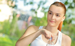 Young vitaly blond woman holding drinking water Royalty Free Stock Photography