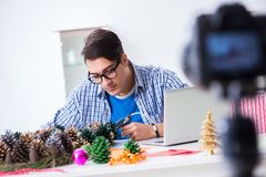 The young vlogger recording video doing christmas decoration royalty free stock photography