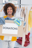 Young volunteer holding clothes donation box Royalty Free Stock Images