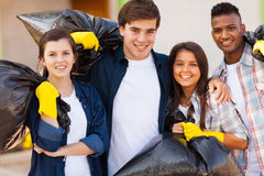 Young volunteers. Cheerful young volunteers with garbage bag after cleaning the streets Stock Photo